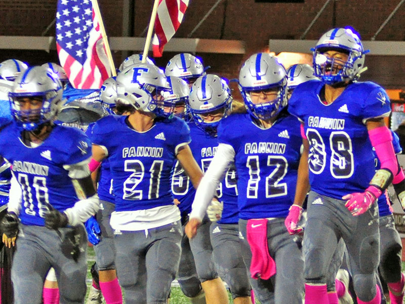 Fannin Rebels Andre Bivens (11), Treylyn Owensby (21),  Luke Holloway (12), and Jalen Ingram (88) lead the Rebels on the field before the game against the North Hall Trojans Friday, October 18.