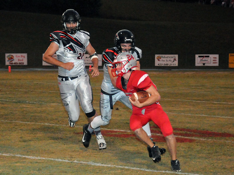 Copper Basin's Chase Mickens looks for yardage against the North Georgia Falcons.
