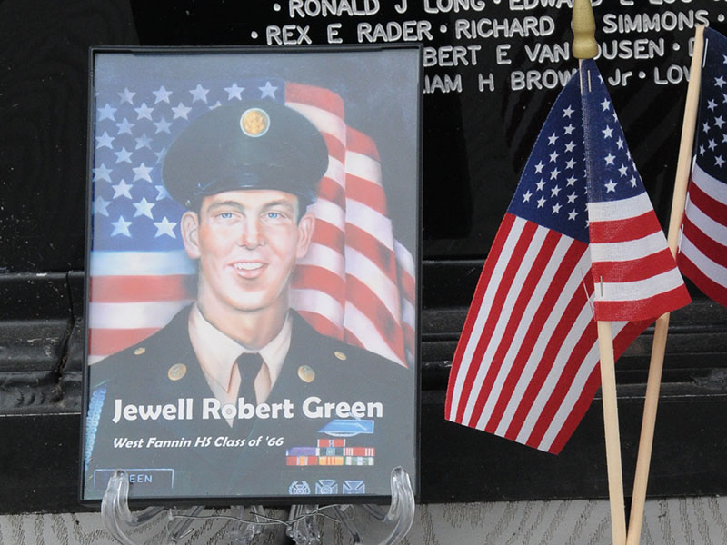 A photo of Jewell Robert Green and a United States Marine Corps coin were at the base of the Vietnam Memorial Traveling Wall Sunday, no doubt placed quietly by those who remembered sacrifices.