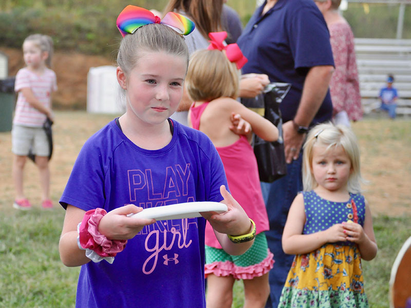 Taber Pass had her game face on as she tossed her frisbee in one of the booths at Fannin County elementary schools' Fall Festival Friday, September 27. The event was held at the Kiwanis Fairgrounds.