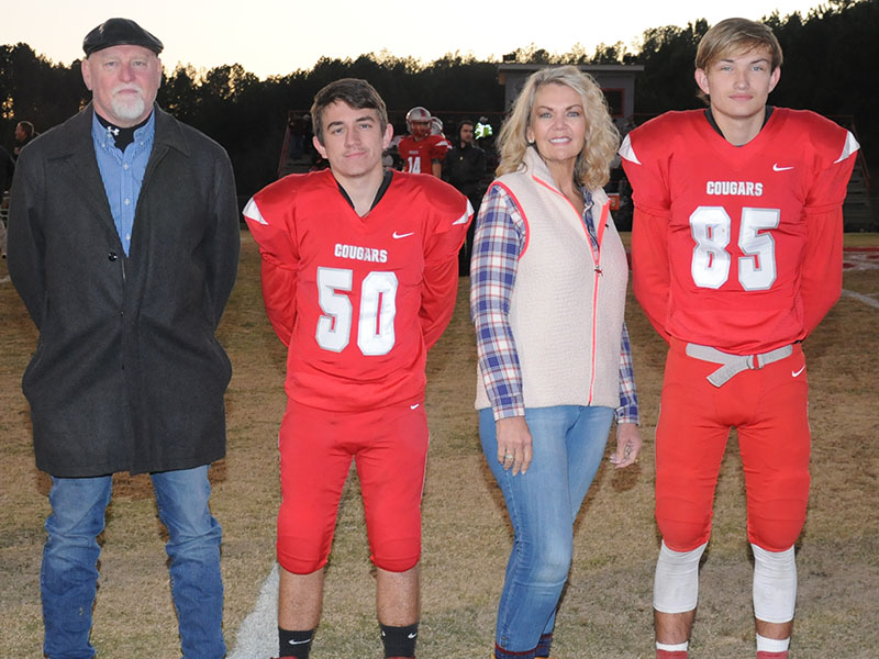 Senior Cougars Jacob Montgomery (50) and Cody Montgomery (85) were honored at Copper Basin's senior night Friday, November 1. They are shown with their parents Johnny and Penny Montgomery.