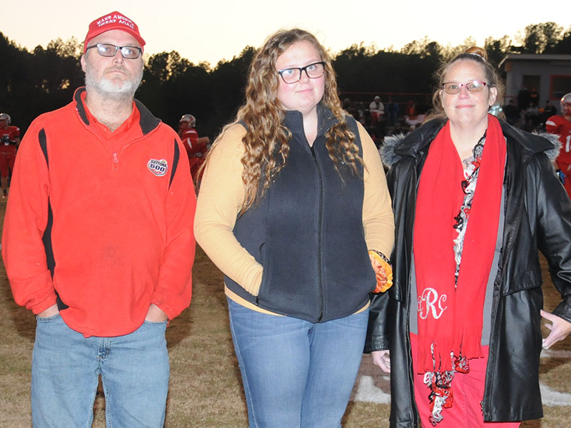 Senior Lady Cougar golfer Alaura Rollins is shown with her parents Tony and Amanda Rollins. Rollins was honored at the senior night ceremonty Friday, November 1.