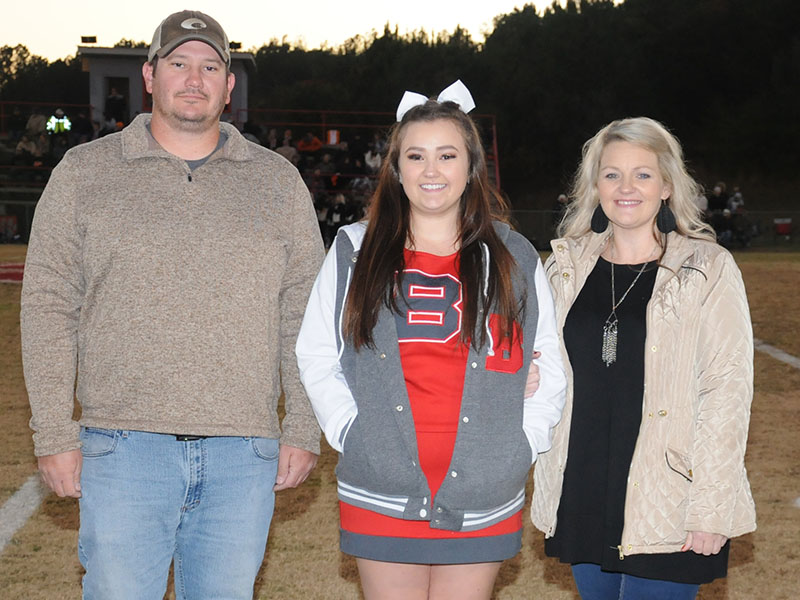 Senior Cheeleader Alexandria Hook was honored at Copper Basin's senior night Friday, November 1. Hook is shown with her parents Jason and Courtney Hook.