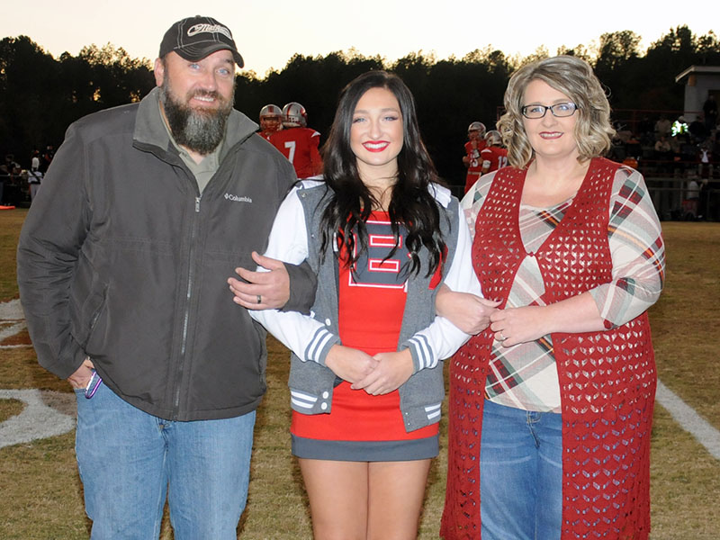 Senior Lady Cougar cheerleader Anna West is shown with her parents Daniel and Amanda West during Copper Basin's senior night Friday, November 1.