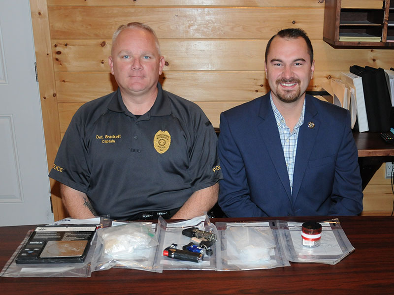 McCaysville Police Chief Michael Earley, right, and Detective Captain Billy Brackett are shown with 87 and a half grams of methamphetamine and assorted drug related objects confiscated during an arrest Thursday, October 31, at Mountain Lane Apartments.