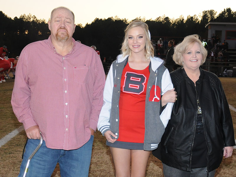 Senior Lady Cougar cheerleader Heaven Self was celebrated at Copper Basin's senior night Friday, November 1. Self is shown with Pat and Cindy Suits.