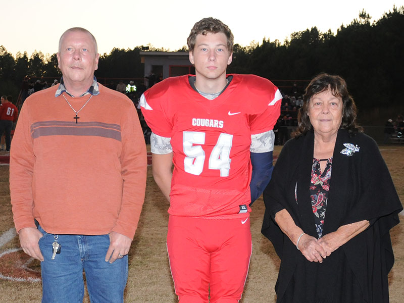 Senior Cougar Jimmy Madar was honored during senior night at Copper Basin Friday, November 1. Madar is shown with Steve Mann and Mary Trembling.