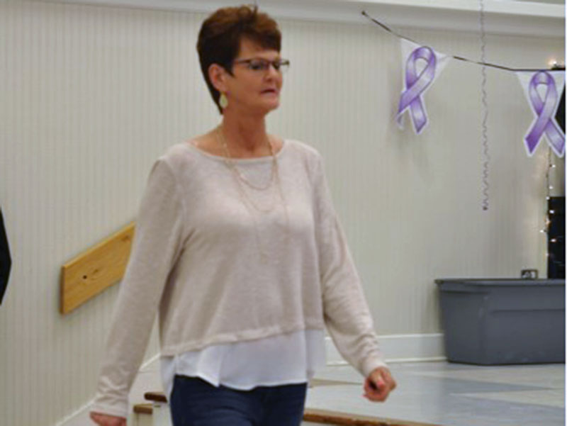 Fannin County cancer survivors will be walking the runway in the 3rd Annual Survivors in Fashion fashion show fundraiser for the American Cancer Society's Relay for Life program, November 16. Shown walking the runway in last year's event is Gail Smith.