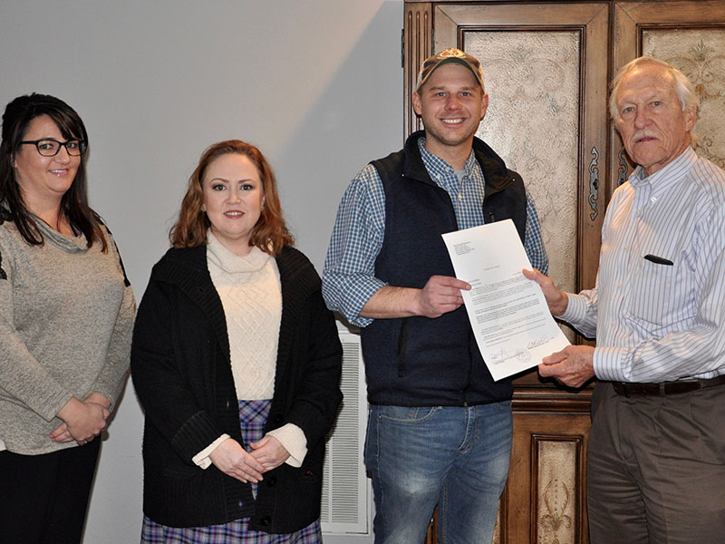 Dr. Bill Whaley presents the deed to his and wife June's land as a donation to the Habitat for Humanity of Fannin & Gilmer counties Monday, November 18. Shown, from left, are Shannon Davenport, Attorney Laura J. Ray, Habitat Executive Director Chris Hall and Whaley.