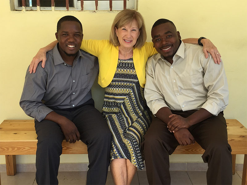 "Pam Reifnsyder is shown with her ""Haitian sons"" Mexny and Anson. Mexny, left, is the son of the founders of the orphanage that Reifsnyder's church supports."