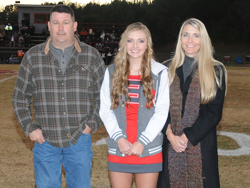 Senior cheerleader Regan Holder was recognized at the senior night ceremony at Copper Basin Friday, November 1. Holder is shown with her parents John and Bobbi Holder.
