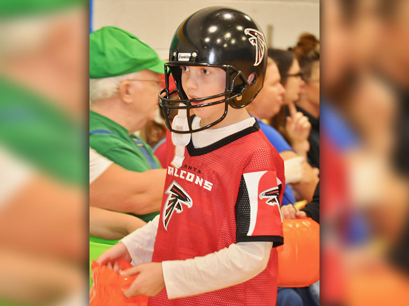 Atlanta Falcon Cash Rittenberry searches for candy at East Fannin Elementary School's Halloween event Thursday, October 31.