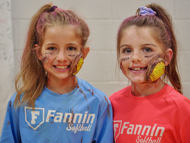 Braylee Davenport, left, and Toccoa Hampton display their grisly softball injuries at East Fannin Elementary School's trick-or-treating event.