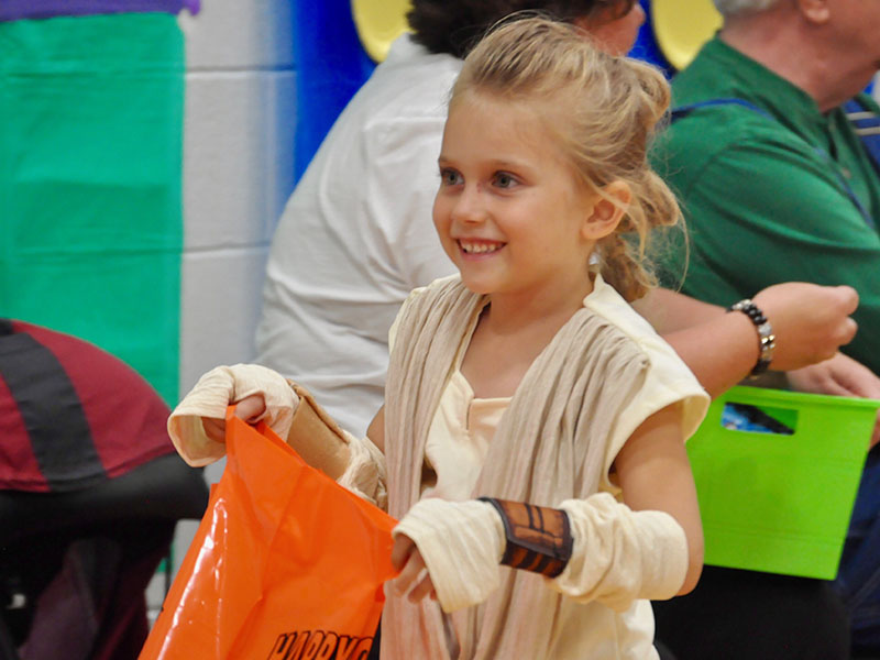 East Fannin Elementary School student Emmalynn Smisson trick-or-treats as Rey from Star Wars during the school's Halloween event Thursday, October 31.