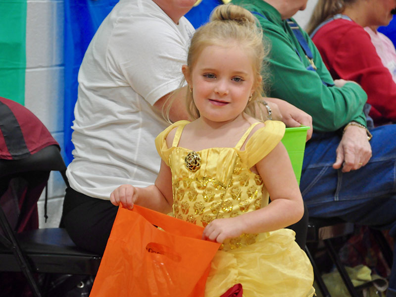 Princess Belle, formerly known as Maggie Nazerian, fills up her bag with candy during East Fannin Elementary School's trick-or-treating event.