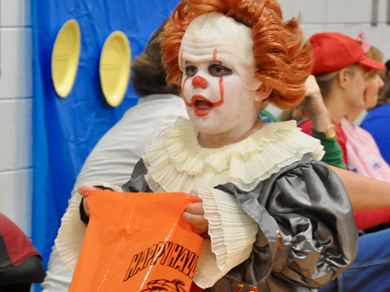 Carson Zimmerman gives people a fright as Pennywise the clown during East Fannin Elementary School's trick-or-treating event.