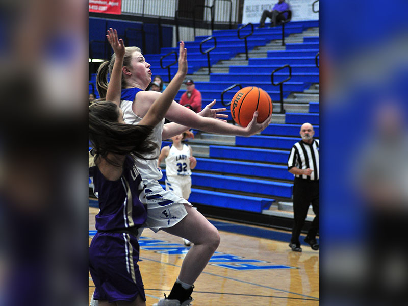 Lady Rebel Morgan Holt goes up for a contested layup during Fannin's region win over Lumpkin Count Tuesday, December 10.