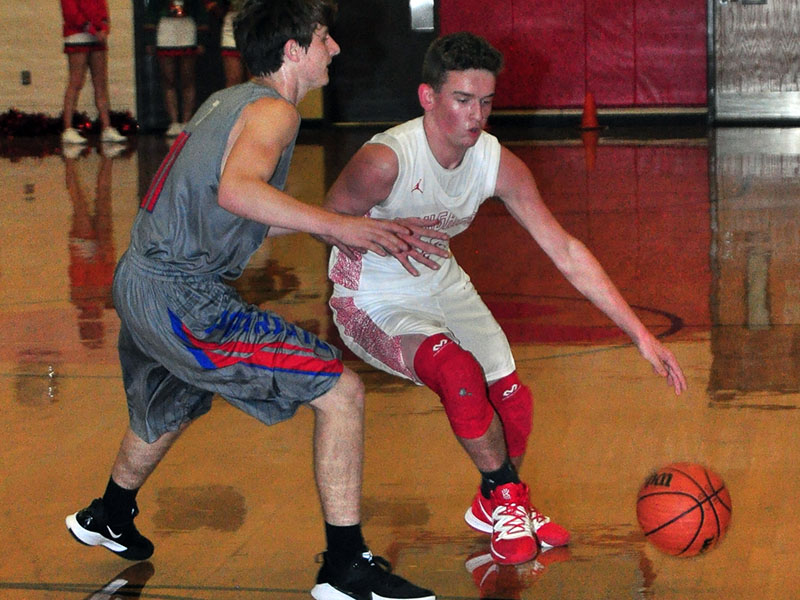 Evan Bobo tries to get around a defender in recent action for the Copper Basin Cougars basketball team.