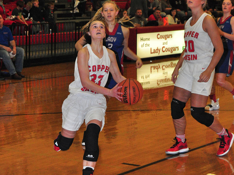 Lady Cougar Emily Hemming gathers for a lay-up in recent action for the Copper Basin Lady Cougars basketball team.