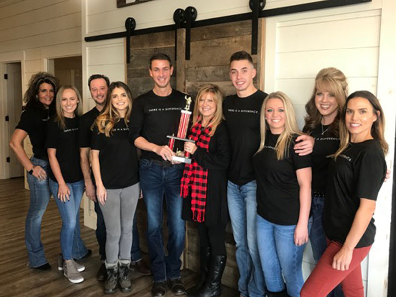 Nathan Fitts & Team with ReMax were the winners of First Community Mortgage's Toys for Tots Challenge. Shown representing are, from left, Kristy Baugh, Hannah Watkins, Daniel Kaylor, Bethany Patterson, Nathan Fitts, Tracie Griffith, Grant Fitts, Blythe Dawson, Kimberly Burger and Brittany Patterson.