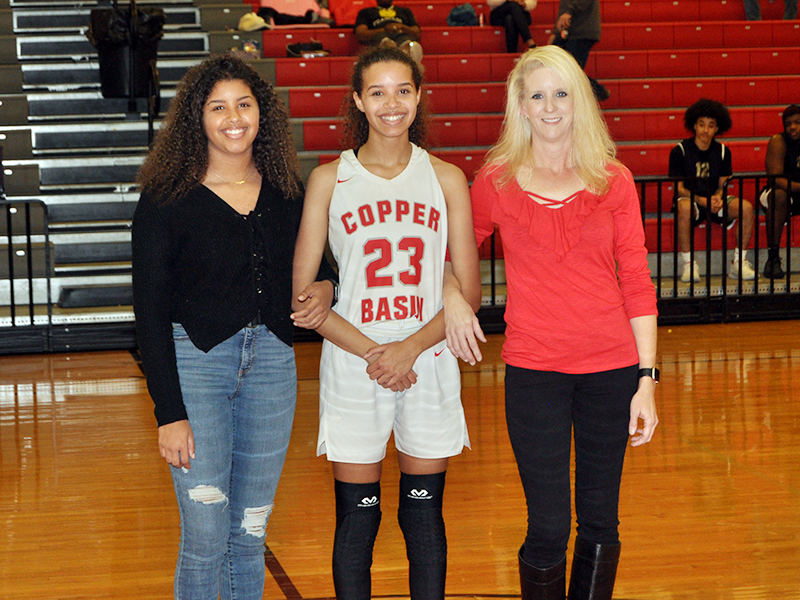 Copper Basin High School celebrated eleven basketball and cheerleading seniors in between games Tuesday, February 18. Brackett is shown with her sister, Ashleigh Brackett, and her mother, Amber Martin.