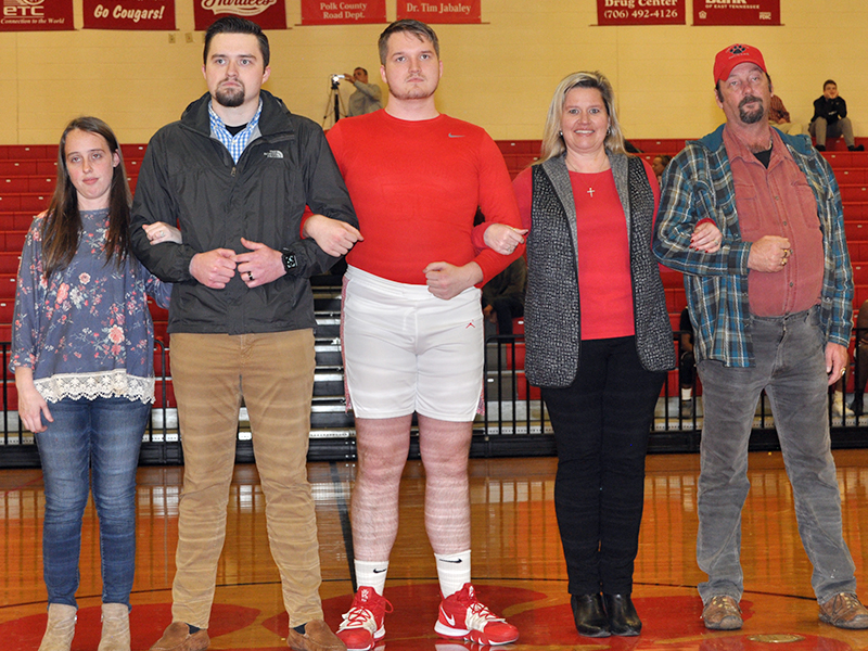 Copper Basin High School honored 11 seniors in between the Lady Cougars and Cougars basketball games Tuesday, February 18. Picture are, from left, Makayla Limburg, Tyler Limburg, senior Collin Limburg, Heather Russell, and Danny Russell.