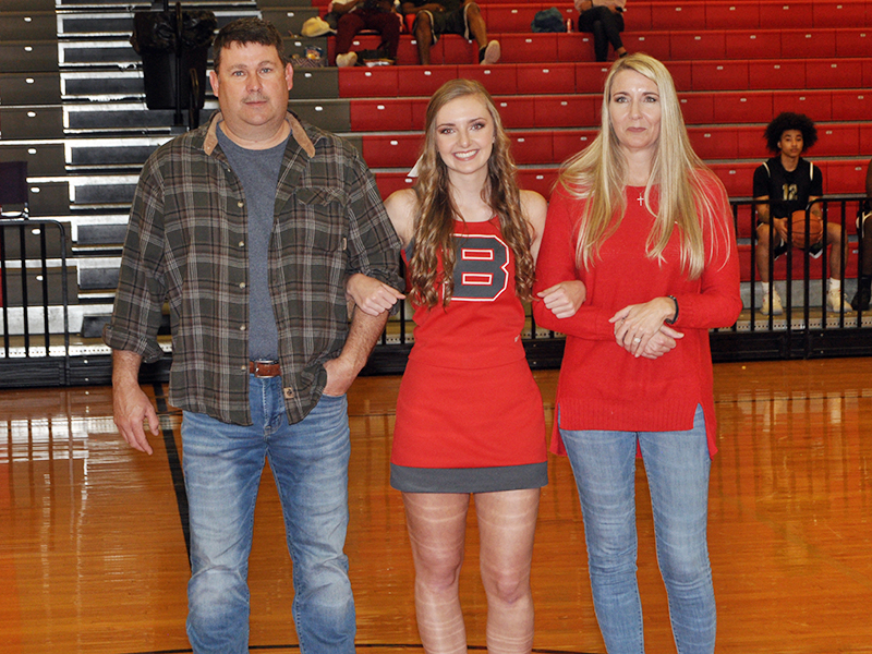 CBHS senior cheerleader Regan Holder was honored in between Copper Basin's varsity basketball games Tuesday, February 18. Holder is shown with her parents John and Bobbi Holder.