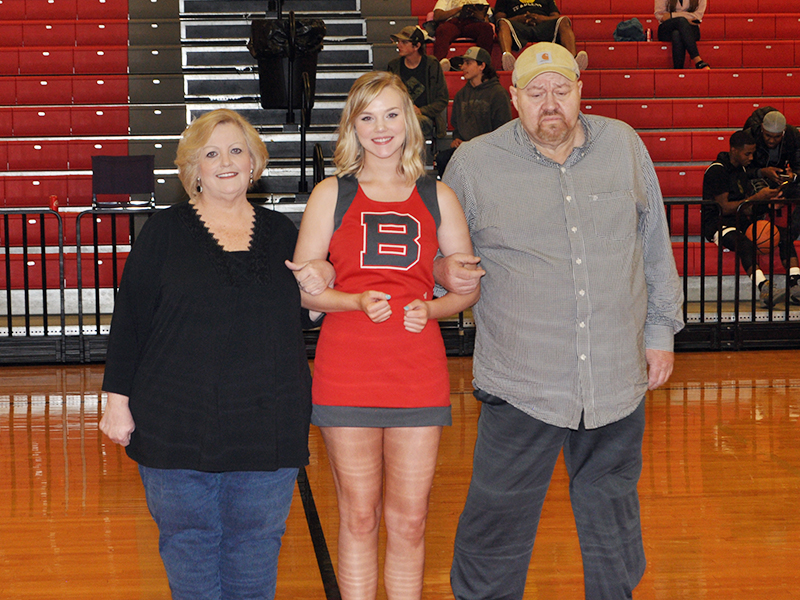 Copper Basin High School cheerleader Heaven Self was honored with 10 other seniors during senior night Tuesday, February 18. Self is shown with her parents Pat and Cindi Suits.