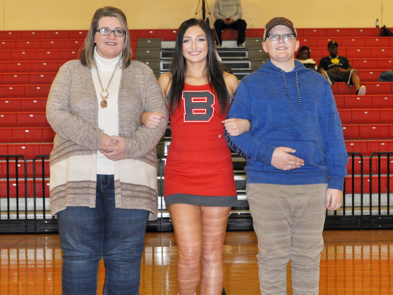 Copper Basin cheerleader Anna West was honored in between the Lady Cougars and Cougars basketball games Tuesday, February 18. West is shown with her mother ,Amanda West and brother, Zeb West.
