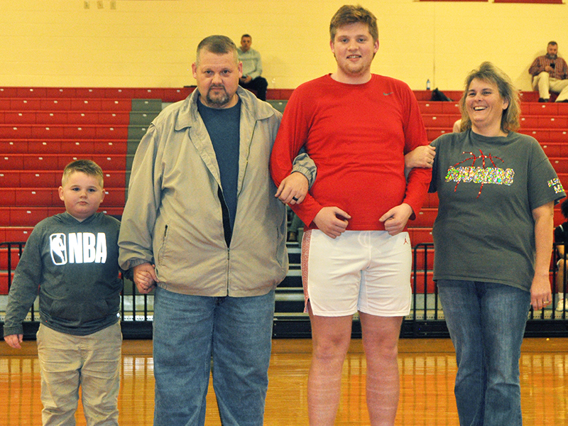 Eleven Copper Basin High School seniors were honored at Copper Basin's senior night Tuesday, February 18. Pictured are, from left, Landon Tallent, brother; Greg Tallent, father; senior Logan Tallent and Leanne Tallent, mother.