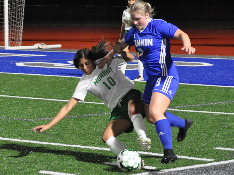 Lady Rebel Sarah Sosebee fights for the ball in recent action for the Fannin County Lady Rebels soccer team.