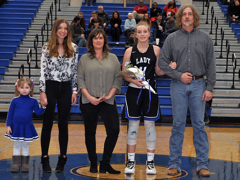 Lady Rebel Saidee Collins was one of eight seniors recognized at Fannin County's home basketball game against Greater Atlanta Christian Friday, January 31. Shown are, from left, Sydney Collins, sister; Savada Collins, sister; Kelly Collins, mother; senior Saidee Collins and Kevin Collins, father.