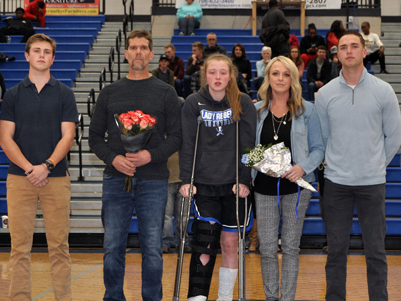 Eight Fannin County High School seniors were recognized at the Lady Rebels and Rebels last home game of the season Friday, January 31. Shown are, from left, Payton Holt, brother; Alan Holt, father; senior Lady Rebel Morgan Holt, Amber Holt, mother and Logan Holt, brother.
