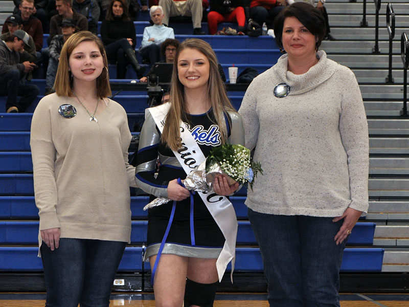 Senior Cheerleader Morgan Mull was celebrated during the senior night festivities at Fannin County's last home basketball game of the season Friday, January 31. Shown are, from left, Madison Mull, sister; senior Morgan Mull and Betsy Mull, mother.