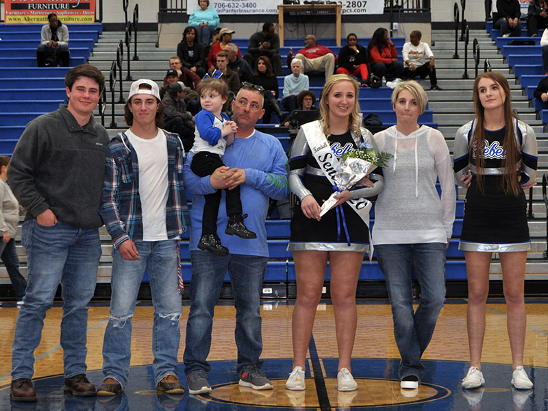 Eight Fannin County seniors were honored Friday, January 31, at Fannin County's home basketball game against GAC. Shown are, from left, Matthew Postell, brother; Caleb Postell, brother; John Postell, father holding Kaylin Postell, sister; senior Kendall Postell, Stacey Postell, mother; and Anna Postell, sister.