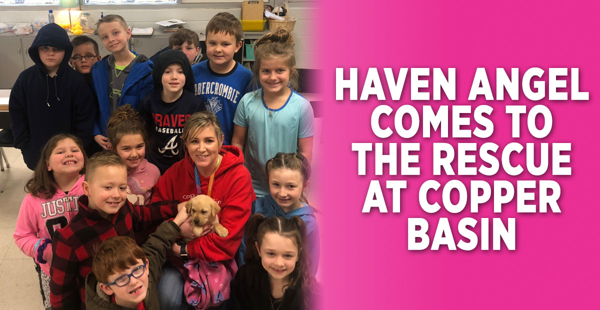 LeAnn Dockery's second grade class at Copper Basin Elementary School gather for a photo while Dockery holds Haven Angel, the school's new pup. Shown are, from left, front, Ethan Hedden, Brody Coleman and Malaney Scoggins; middle, Makenna Stone, EmmaSue Hughes, Dockery and Kallie Mosley; back, Zeke Allen, Edward Cole, Braydon Curtis, Braxton Lisk, Avery Chin, Briar Hicks and Madden Beach.