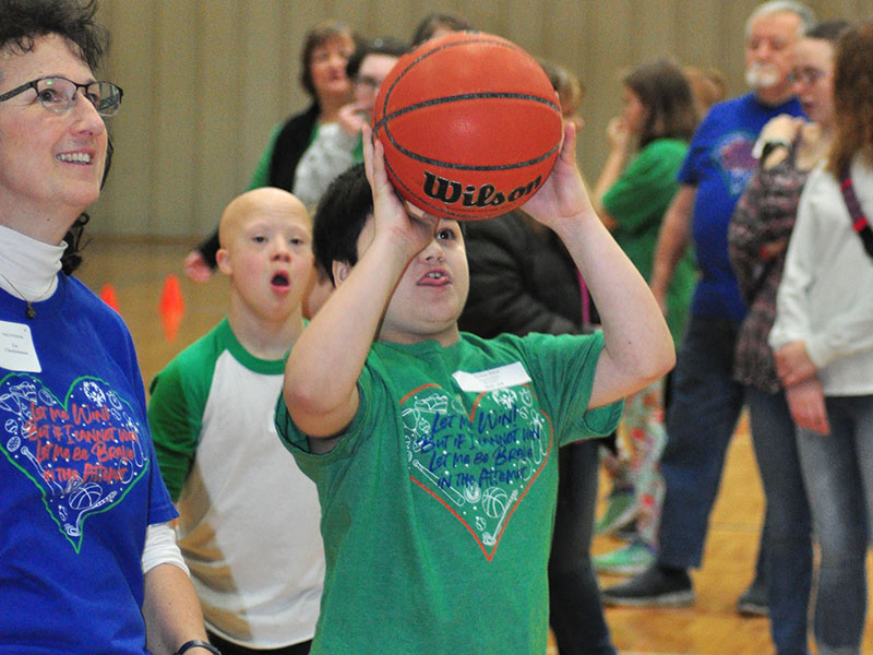 Special Olympics athlete Damian Hilton goes up for a bucket during the Fannin County Special Olympics basketball competition at the Fannin County Recreation Center Friday, January 31.