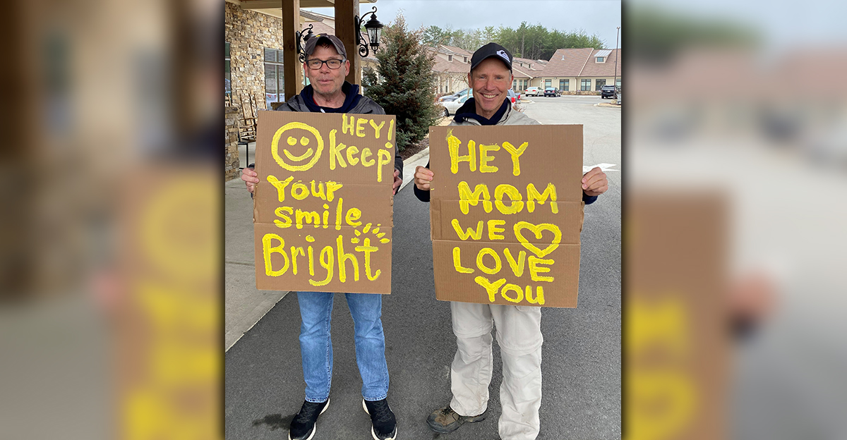 Jeff Pierce and Ryan Pierce created signs to cheer their mom, Blue Ridge Assisted Living & Memory Care resident Carolyn Pierce, who is unable to receive visitors during the COVID-19 pandemic.