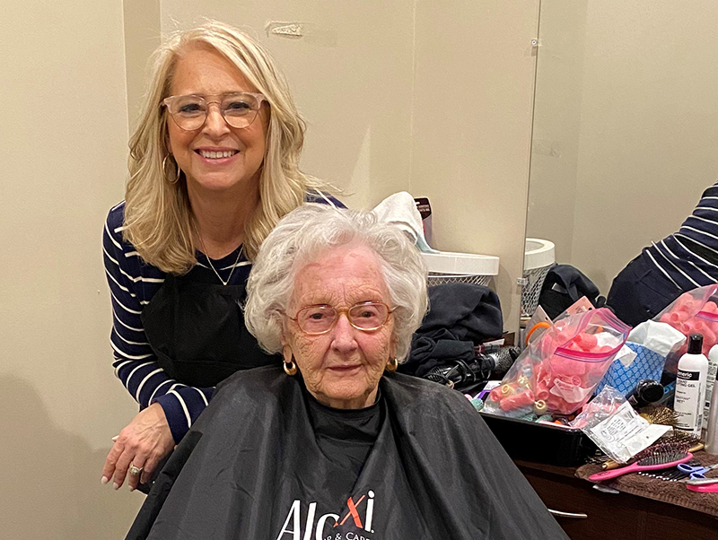 Blue Ridge Assisted Living & Memory Care resident Maxine Ross enjoyed having her hair washed and styled by Senior Lifestyle Counselor Cindy Querry while her regular hair appointments have been put on hold due to COVID-19. Querry said she warned Ross that the job might not be as professional as the one she usually receives.