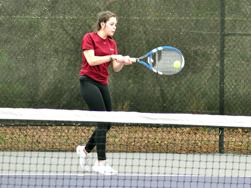 Lady Rebel tennis player Brook Patton keeps a volley alive in recent action for the Fannin County High School tennis team.