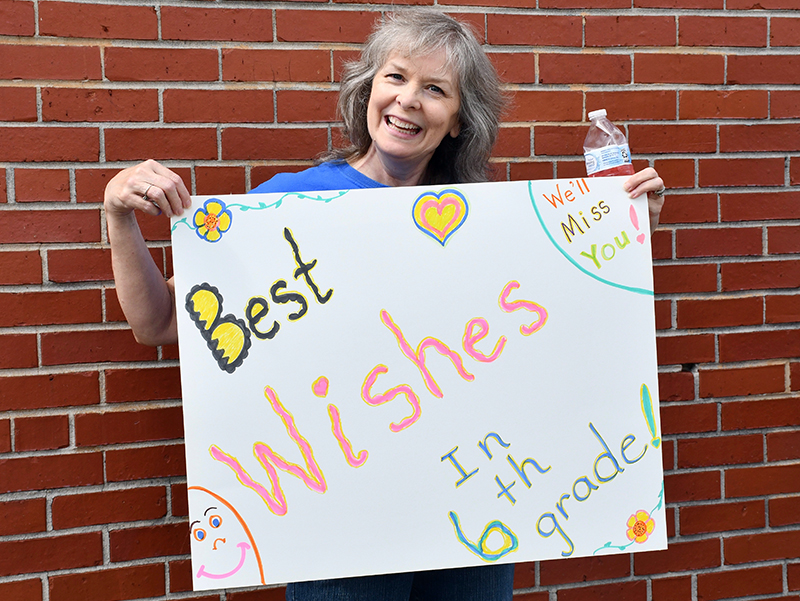 East Fannin Elementary School Paraprofessional Brenda Thomas sends her best wishes to the school's graduating fifth grade students during the school's Fifth Grade Parade Thursday, May 21. A similar event took place at Blue Ridge Elementary.