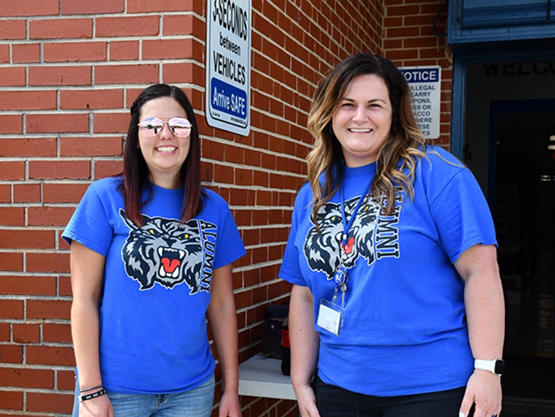East Fannin Elementary School Pre-K Teacher Tessa Rogers, left, and Special Education Teacher Jenna Saxon take part in the school's Fifth Grade Parade Thursday, May 22.