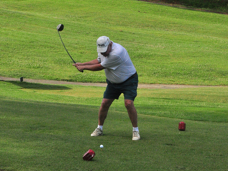 Ron Hartness loads up on a drive on the first hole at the Copper Basin Golf Club Thursday, June 11.