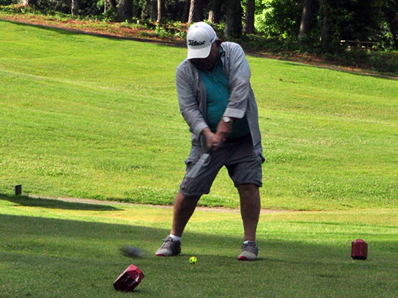 Dr. Howard Tilley tees off on hole one at the Copper Basin Golf Club Thursday, June 11.