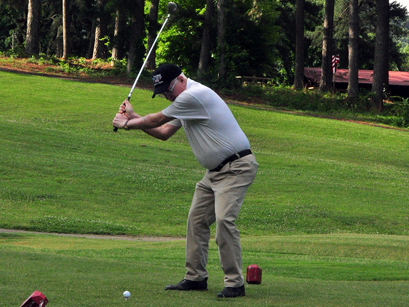 Golfer Bill Huff squares up a ball at the Copper Basin Golf Club Thursday, June 11.