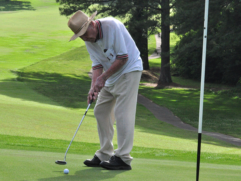 Dale Dyer putts the ball in the hole during Thursday's golf match at the Copper Basin Golf Club June 11.