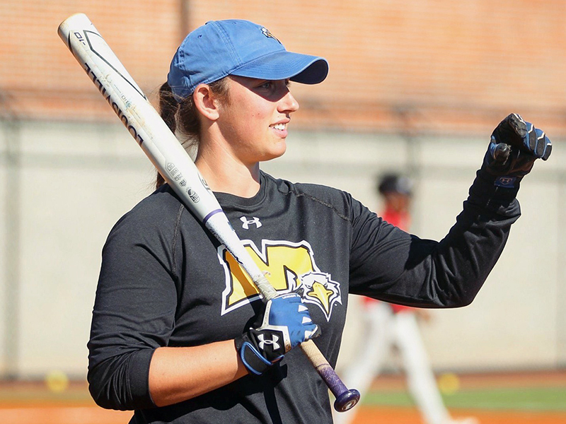 FCHS alumnus Karly Thompson warms up the team during her time as a Graduate Assistant Coach at Morehead State University.