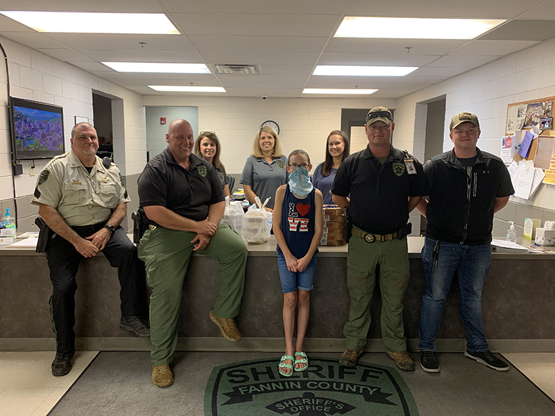 Lacey Holloway recently delivered meals to the Fannin County Sheriff's Office as part of her effort to Back the Blue. Shown with Lacey are, from left, front, Sergeant John Bramlett, Investigator John Arp, Investigations Captain Justin Turner and intern Hayden Smith; and, back, Faith Hensley, Amber Twiggs and Jessica Lunsford.