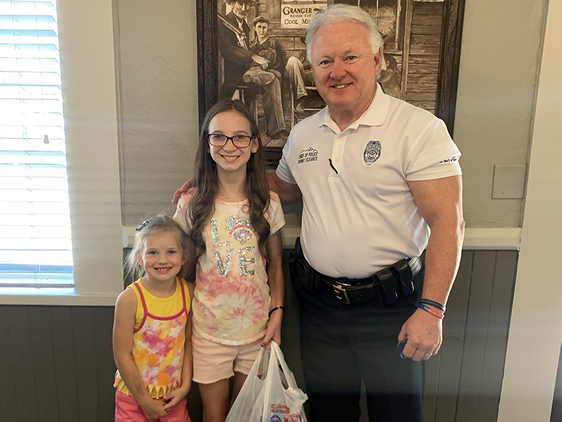 Lacey Holloway and her sister, Londyn, delivered meals for the Blue Ridge Police Department to Chief Johnny Scearce.