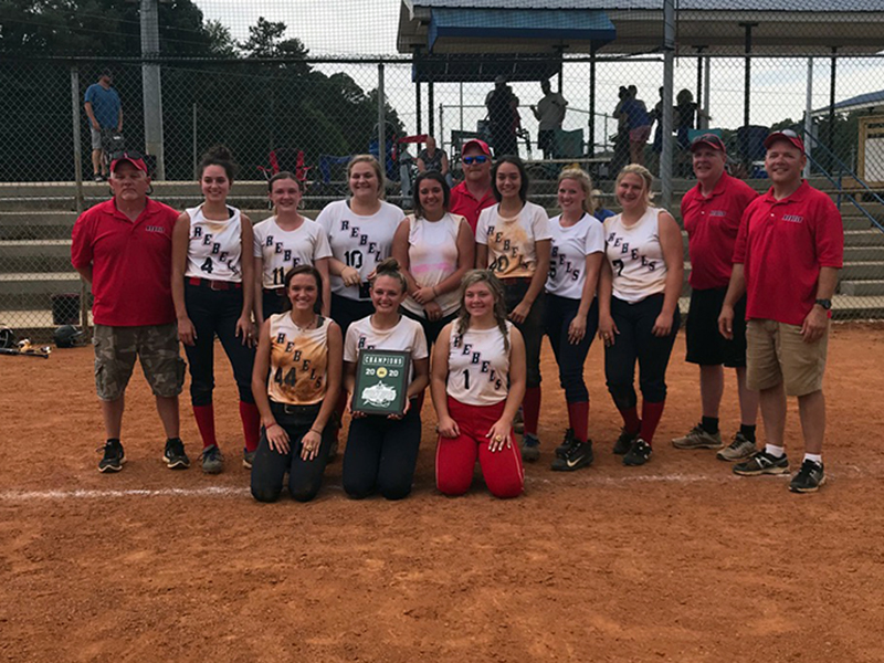 The Lady Rebels travel softball team won the World Series in Cleveland, Tennessee, Saturday, June 25 through 28. Shown, following the victory, are, from left, front, Riley Smith (Copper Basin), Payton Palmer (Hiwassee Dam) and Kaitlyn Goode (Copper Basin); middle, coach David Goode, Rylie Payne (Hiwassee Dam), Lauren Brooks (Hiwassee Dam), Allison Stiles (Hiwassee Dam), Carly Curtis (Andrews), Sydney Payne (Hiwassee Dam), Ansleigh Hogsed (Murphy), Riley Dockery (Murphy), head coach Mark Brooks and coach Sha